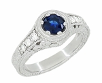 Art Deco Filigree Flowers and Scrolls Engraved Blue Sapphire and Diamond Engagement Ring in 18 Karat White Gold