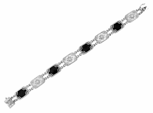 Art Deco Filigree Onyx and Diamond Set Bracelet in 14 Karat White Gold - Click to enlarge
