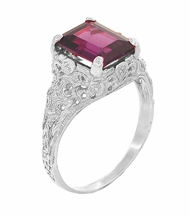 Filigree Emerald Cut Rhodolite Garnet Edwardian Engagement Ring in 14 Karat White Gold - Click to enlarge