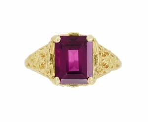 Edwardian Filigree Emerald Cut Rhodolite Garnet Engagement Ring in 14 Karat Yellow Gold - Click to enlarge