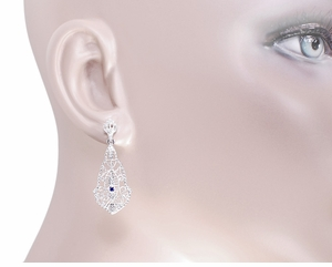 Art Deco Filigree Sapphire Dangling Earrings in 14 Karat White Gold - Click to enlarge