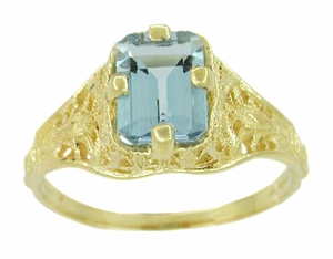 Art Deco Emerald Cut Aquamarine Filigree Engagement Ring in 18 Karat Yellow Gold - Click to enlarge