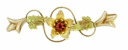 Antique Victorian Ruby Flower and Leaves Brooch in 9 Karat Tri Color Gold