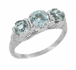 Art Deco Aquamarine Filigree Three Stone Ring in 14 Karat White Gold