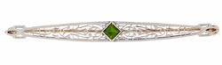 Art Deco Filigree Peridot Bar Brooch in 14 Karat White and Yellow Gold