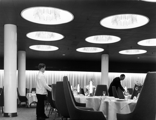 Featured photograph, of the restaurant of the SAS Royal Hotel, designed by Arne Jacobson and completed in 1960, is reproduced from Grand Hotel, published by the Vancouver Art Gallery and distributed by ARTBOOK | D.A.P.