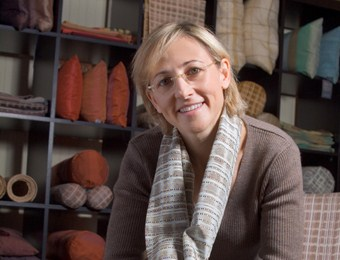 Eve Blossom, a former architect and a business school dropout, is using her design skills to reinvent the supply chain, starting with the textiles industry. Her company, Lulan Artisans, is generating profits for itself and for some 650 weavers, dyers, spinners and finishers around the world--including in Cambodia, Laos, Thailand, Vietnam and India.  Here