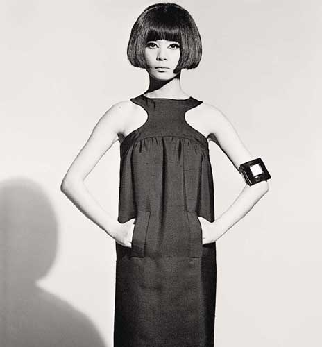 "Featured image, of model Hiroko Matsumoto posing for ""Ces Collections romantiques Pierre Cardin"" in the March 3, 1966, edition of French Elle, is reproduced from"