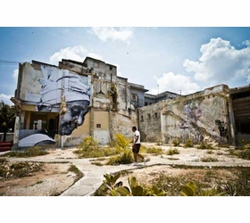 Featured image is reproduced from <I>JR & Jos� Parl�: Wrinkles of the City, Havana, Cuba</I>.