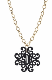 filigree cross monogram on greenwich chain