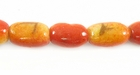 Oval Limestone Apple Coral Beads
