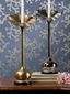 Dessau Home Antique Brass Flower Candleholder On Black Marble