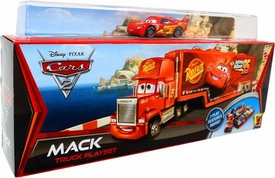 Disney / Pixar CARS 2 Movie Mack Truck Playset with Bonus 1:55 Die Cast Race Team Lightning McQueen