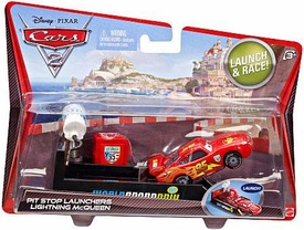 Disney / Pixar CARS 2 Movie Pit Stop Launchers with 1:55 Die Cast Car #95 Lightning McQueen