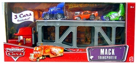 Disney / Pixar CARS Movie Exclusive Mack Transporter with 1:55 Die Cast Cars DJ, Snot Rod & Wingo