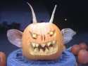 A Pumpkin Carving With Pig's Ears and Parsnips