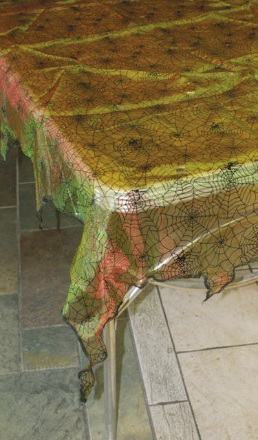 Iridescent  green spider web table cloth