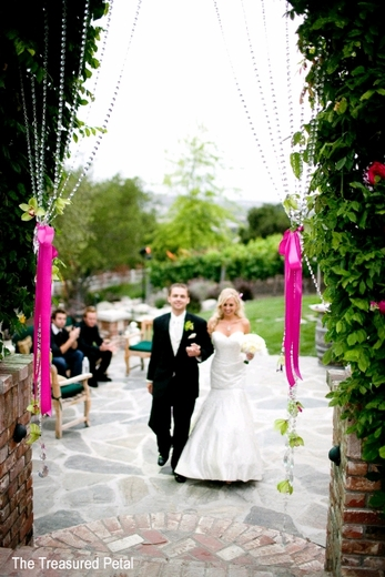 Crystal Garlands Woven Into Wedding Arch