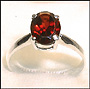 Genuine Garnet Solitaire Ring in  Silver