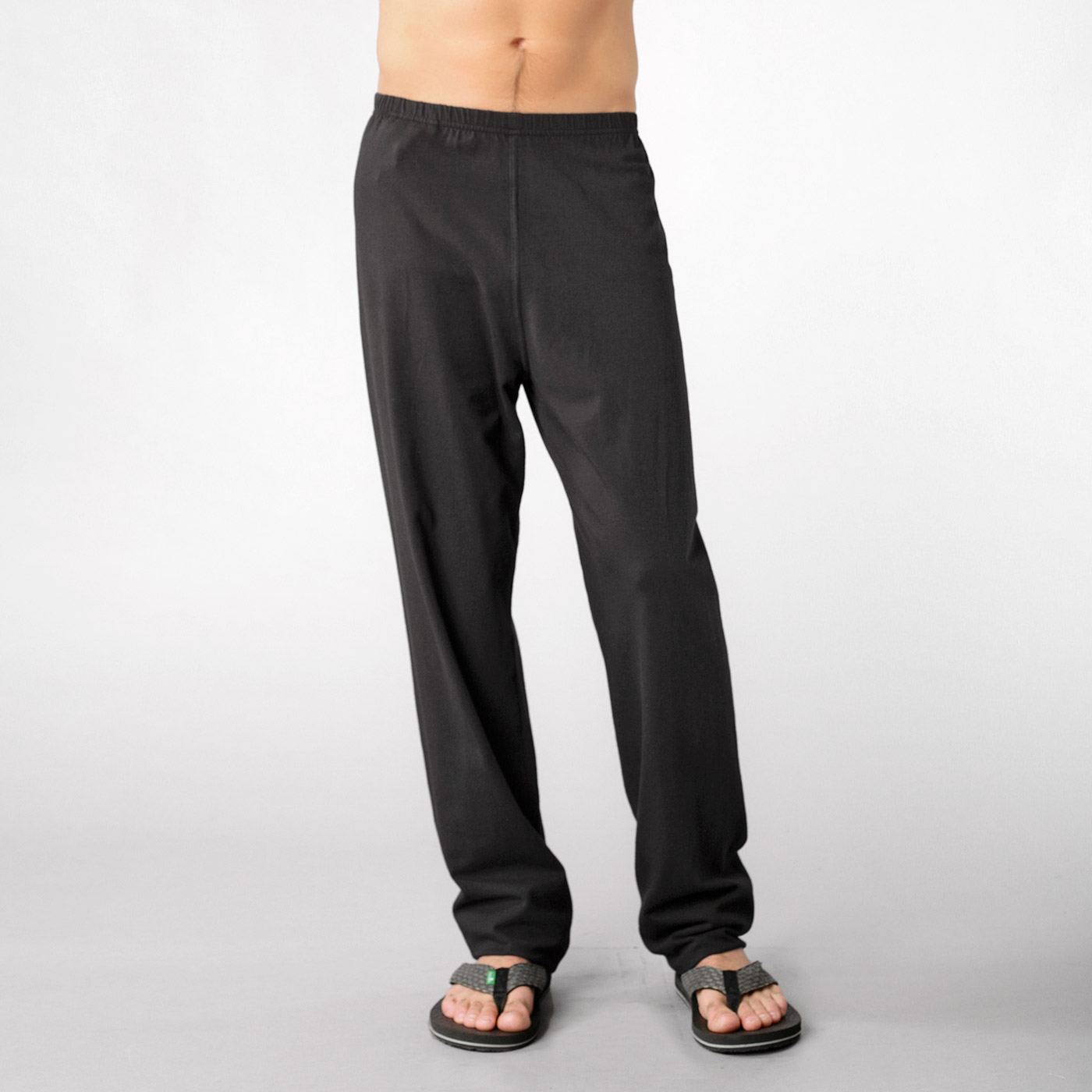 While you might see a lot of men sporting shorts in yoga class, there is a reason for yoga pants. In yoga, whether it's hot or not, pants work to absorb the sweat, so when you get into an arm balance, you can hold it for longer without the sweat on your knees or legs causing your arms to slide off of them.