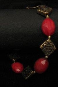 Antique Gold Charm with Red Crystal