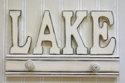White wood Lake sign with pegs