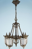 Cast iron chandelier with 5 hanging glass cup shades <NOBR>(ca. 1930s)</NOBR>