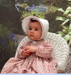NEW Sarah Louise Red Roses Print Smocked Baby Dress with Embroidered Hearts (CC05316) with NEW White Bonnet with Hearts and White Ribbon Insertion (BB0618)
