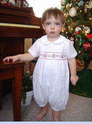 <strong>Baby Zack in Smocked Holiday Romper