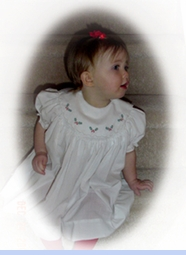 <strong>Baby Caitlin in Smocked Holiday Dress</strong>