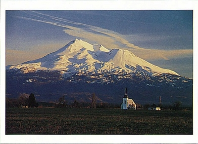 MOUNT SHASTA WITH WINTER SNOW CAP AND A CHURCH AT SUNDOWN, LITTLE SHASTA, CA