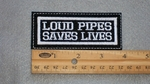 42 L - LOUD PIPES SAVES LIVES - EMBROIDERY PATCH - WHITE