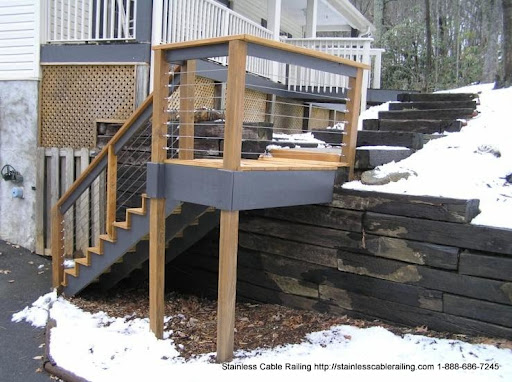 Wood Top Rail and Wood Posts with a cable railing system