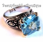 BEAUTY FOR ASHES SIGNATURE AQUA BLUE TOPAZ CZ TWO TONE RING