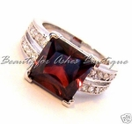 CENTER STAGE DESIGN GARNET & CLEAR CUBIC ZIRCONIA RING