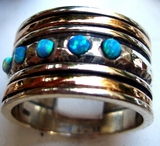 Israeli spinner ring with opals