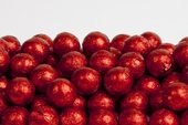 Red Foiled Milk Chocolate Balls (25 Pound Case)