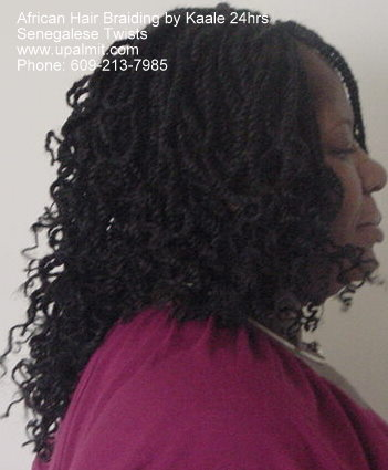 Long, curly senegalese kinky twists- side view.
