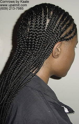 Mediium cornrows with 180 degree wave design in back, right side view.