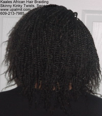 Kinky twists hide receding hairline and male pattern baldness.