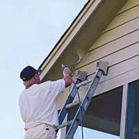 Standing on ladder Spraying  with airless extension
