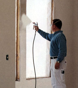 Man spraying with paint sprayer