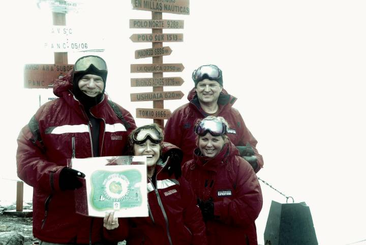 Bob Kerstein and Friends holding a Trans - Antarctica Expedition Certificate at Base Brown, Antarctica in February 2013