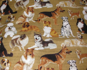 Fabric with various dog breeds on it. Mostly dark colors - brown and black.