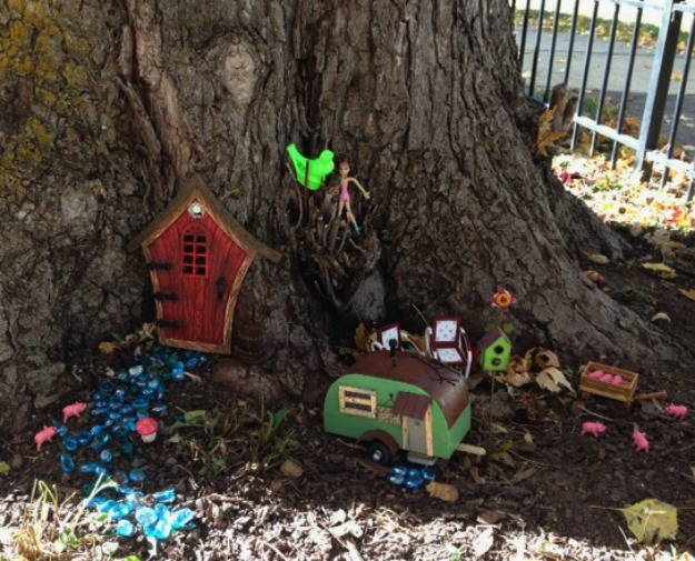 Autumn Fairy Garden Scene with Plastic Pigs and a Trailer