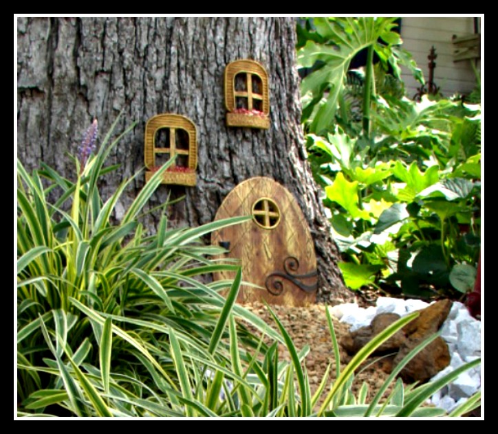 Trio Of Fairy Doors On Tree Trunk