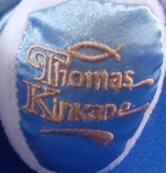 picture of famous Thomas Kinkade trademark on collectible licensed bear's left foot