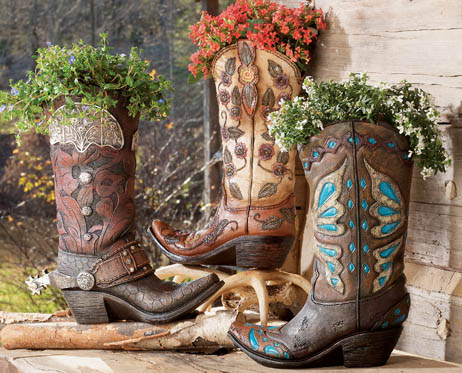 cowboy boot planter... MAYBE I will do this with mom's boots.. not ...